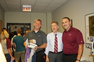 picture of Professor Rick McKinnies, President Randy Dunn, and Professor and Director Scott Collins